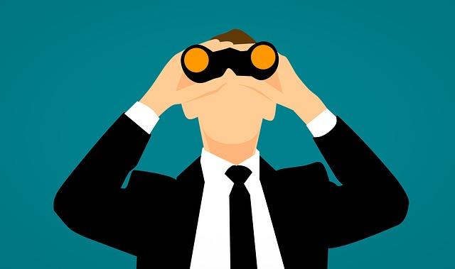 双眼鏡ののぞくビジネスマン