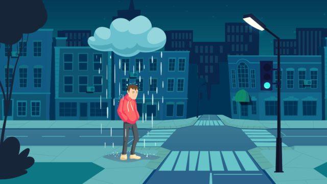 街中で雨に降られる男性