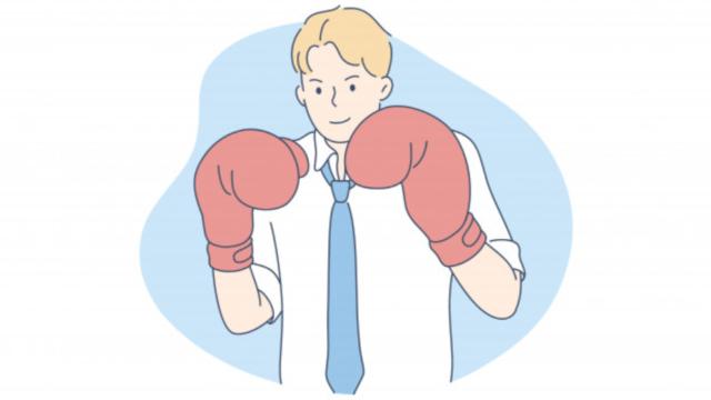 ボクシングをする男性ビジネスマン