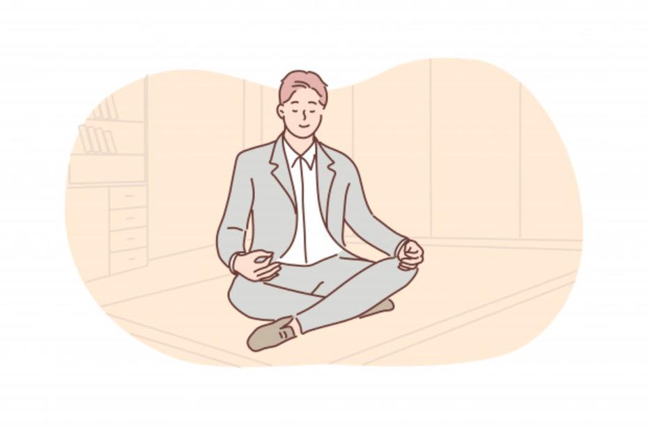 瞑想をしてリラックスする男性ビジネスマン